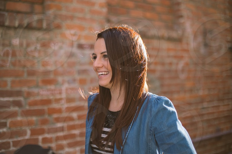 Smiling woman in brick alley photo