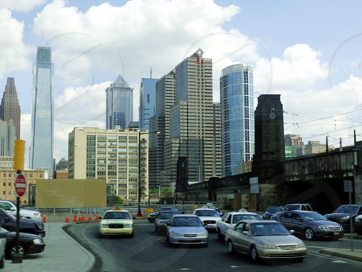 Philadelphia city skyscrapers buildings sky blue clouds traffic photo