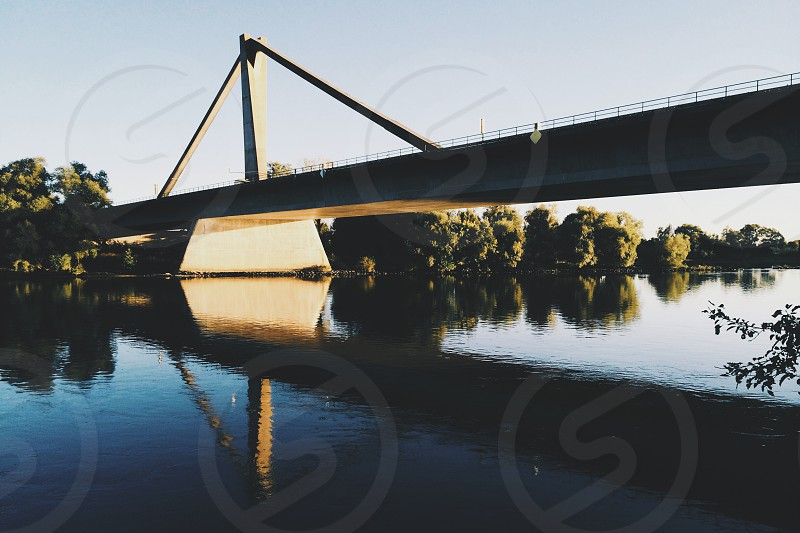 bridge over river danube with reflection photo