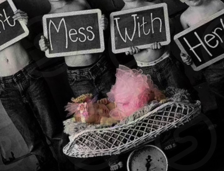 selective photo of don't mess with hear words written on chalk board separately hold by children's top naked wearing blue denim jeans in front of baby in pink ruffle dress and pink headband s photo