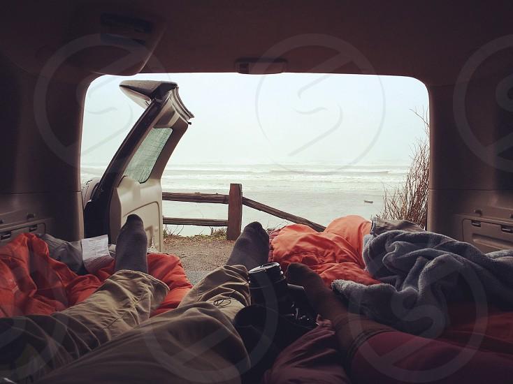 people laying down in van photo