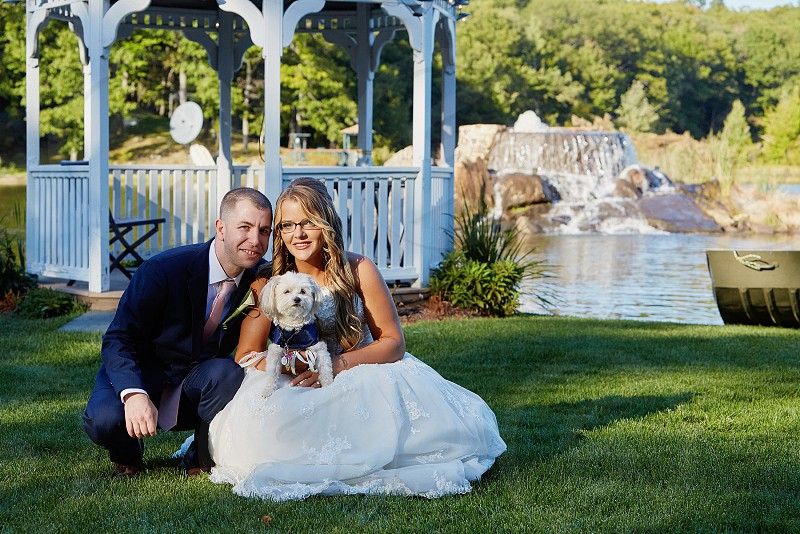 Bride and groom bride groom and dog wedding day wedding dog flower dog dog of honor family perfect pup pampered pup beautiful day our family photo