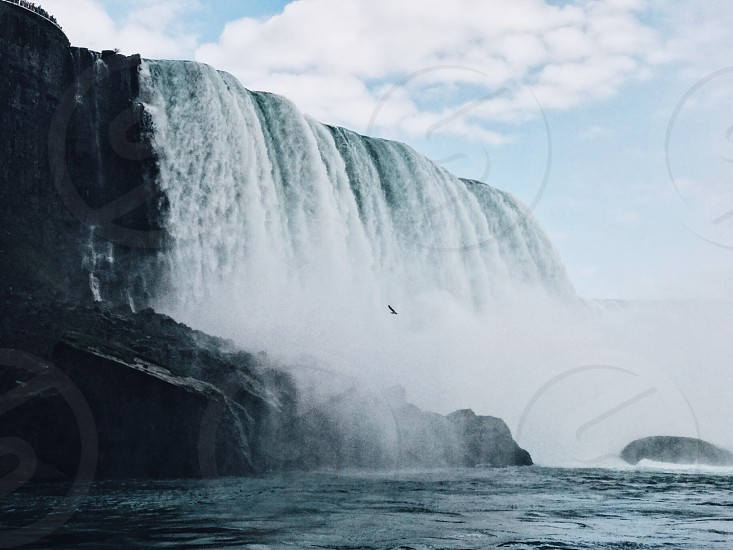Niagara Falls modern art landscape beautiful wonderful cool water boat mist fog awesome mighty cliff waterfall Canada buffalo New York river lake blue rocks contrast nature birds hornblower maid of the mist sky clouds rushing water danger bird long exposure large photo