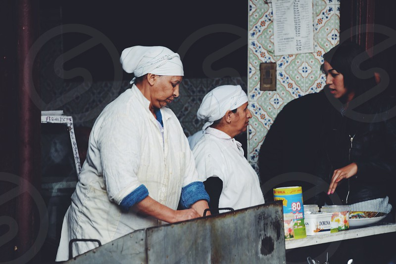 Women preparing dishes at the Souk of Marrakech  photo