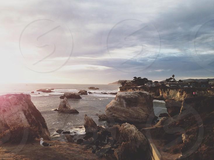 rock formation near ocean view photo
