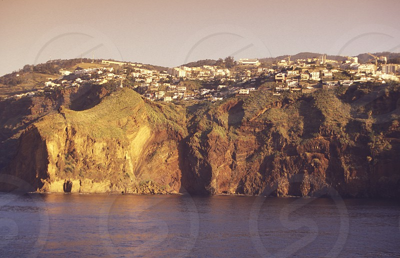 the coast and cliffs near the city of Funchal on the Island of Madeira in the Atlantic Ocean of Portugal. photo