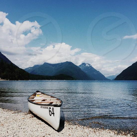 canoe on lake shore photo