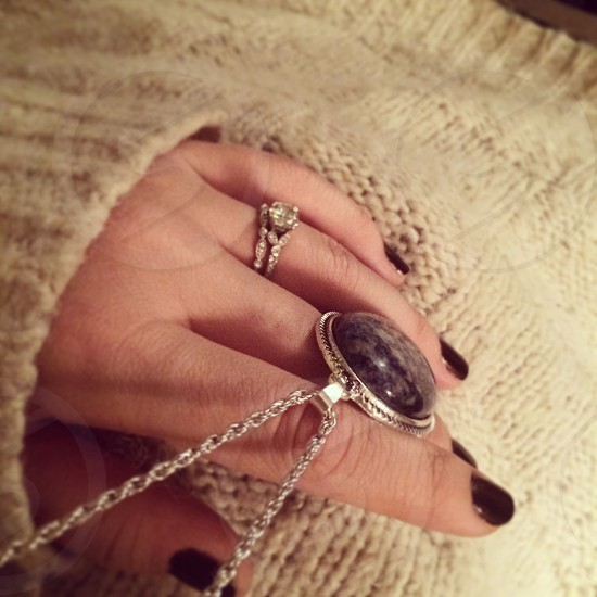 Over-sized wool sweaters dark nails long pendants  photo