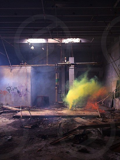 abandoned room with yellow and red smoke photo