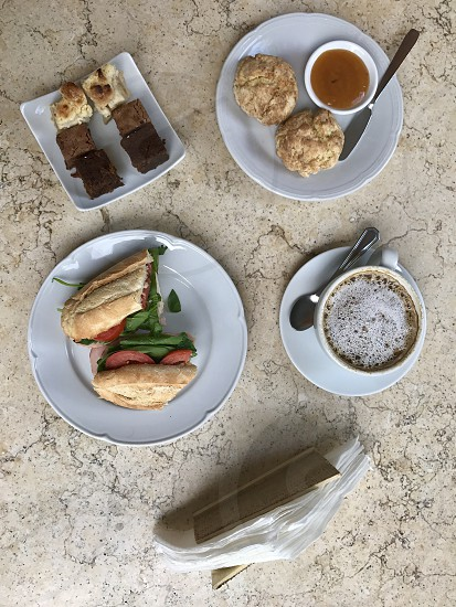 Top view of brunch with sandwich coffee jam and pastries photo