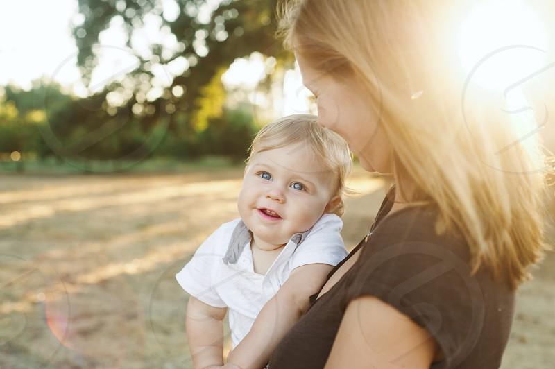 baby's white collared short sleeve shirt photo