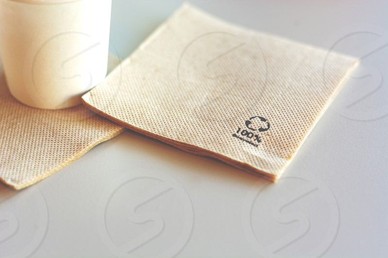 Disposable napkin made from recycled paper. Environmental protection and ecology. photo