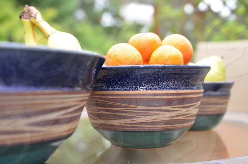 Three pottery bowls with fruit photo