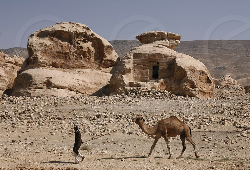 a House near the Treasury of the little Petra in the Temple city of Petra in Jordan in the middle east. photo