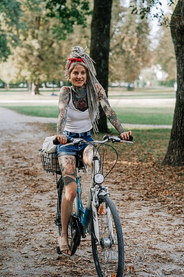 natural lifestyle portrait of empowered alternative woman wearing no make up covered in tattoos  photo