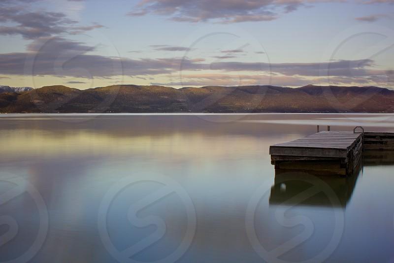brown wooden pier on brown lake  photo