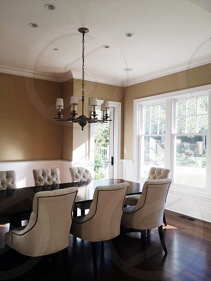 room with white dining chairs photo