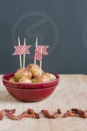 Spanish tapas 'Bravas'. Spicy fried potatoes with chilly sauce photo