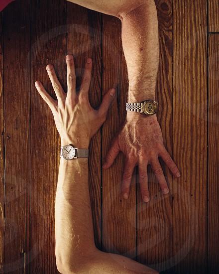 gold analog wristwatch photo