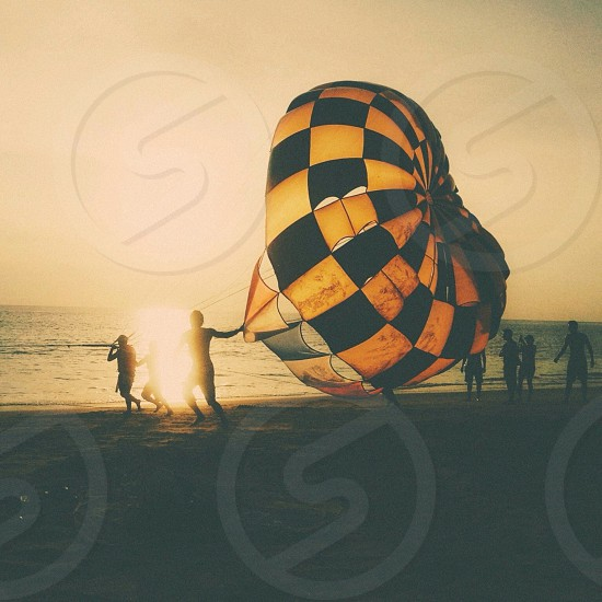 yellow and black checked parachute photo
