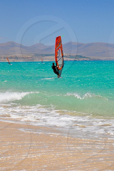 Surfing in the Atlantic Ocean on Fuerteventura canary island in Spain  photo