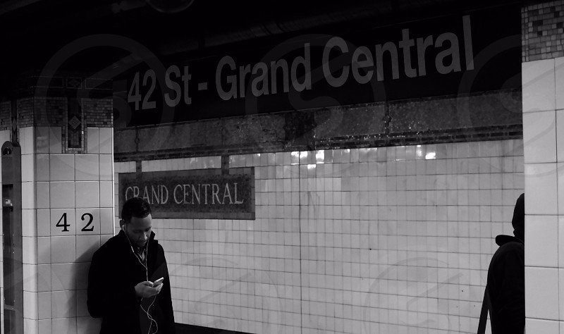 Mobile phone on public transport grand central station NYC New York City waiting for the train!  photo