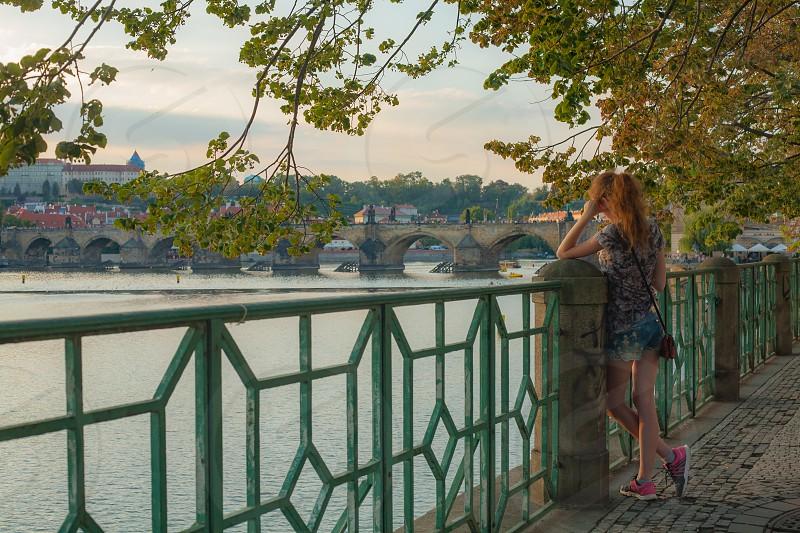 Tourists enjoy Autumn in Prague photo
