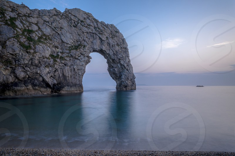 Durdledoor arch long exposure evening twilight sea seascape Dorset iconic water soft rock photo
