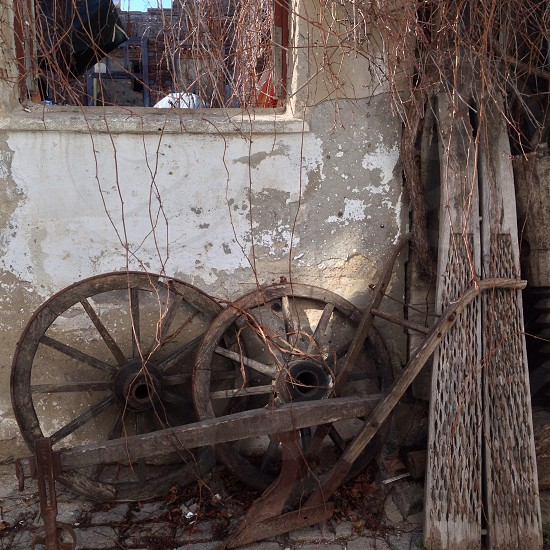 wood wagon wheels against wall photo