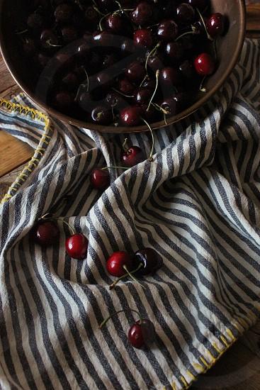 Fresh summer cherries in an antique copper bowl. photo