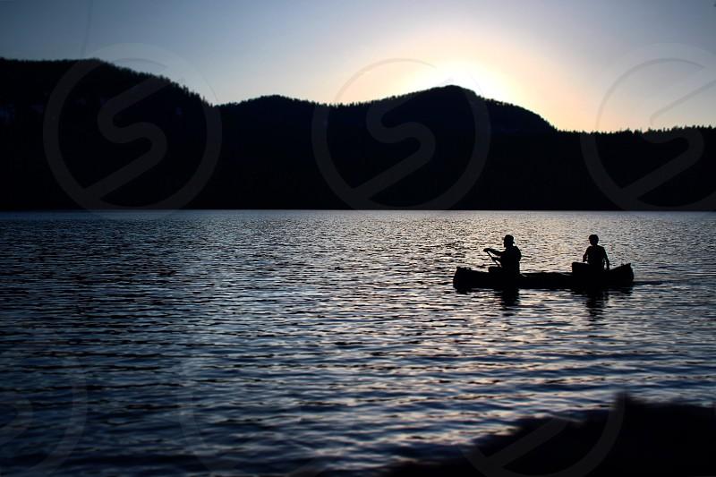 camping mountain lake canoe sky twilight  photo
