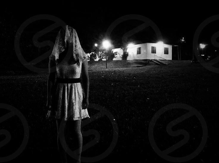 woman in white tank dress standing photo