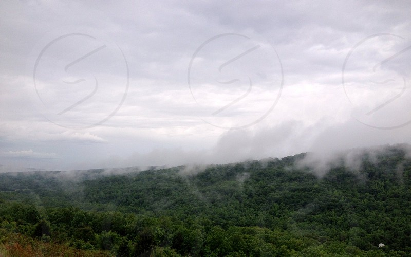 Fog rising off a mountain after a storm photo