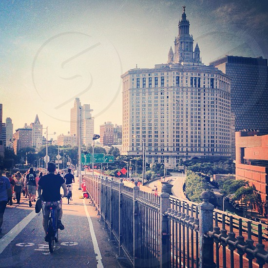 Cyclists and walkers on the Brooklyn Bridge heading toward Manhattan. photo