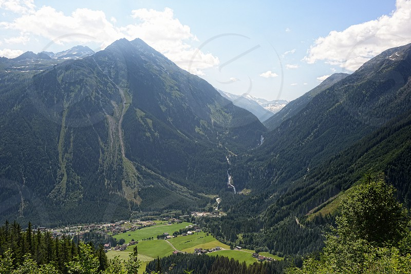 aerial view into a Krimml waterfalls achen valley high taunern mountain area nation park. photo