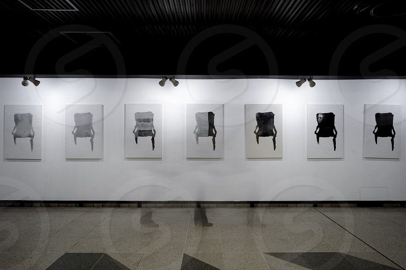 Seven chairs in a row photo