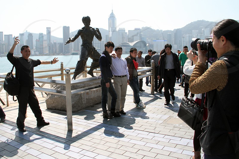 Asian travellers posing and taking pictures in Hong Kong waterfront photo