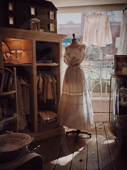 Vintage summer dress near an antique store window photo