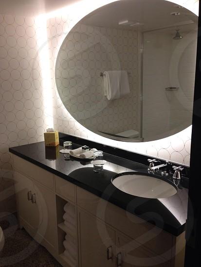 bathroom vanity with oval mirror photo