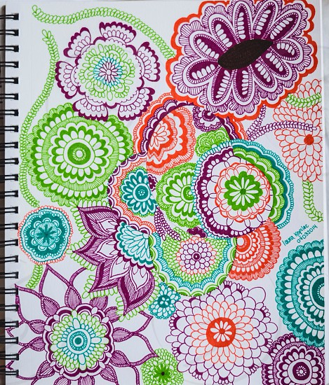 white spiral note book with green purple and orange floral print photo