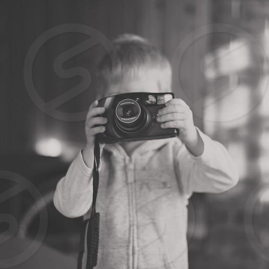 Small boy taking photos photo