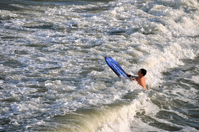 Boy body-boards in the ocean waves - Myrtle Beach South Carolina - USA photo