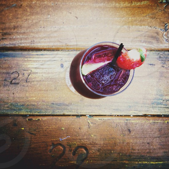clear drink glass with plum liquid photo