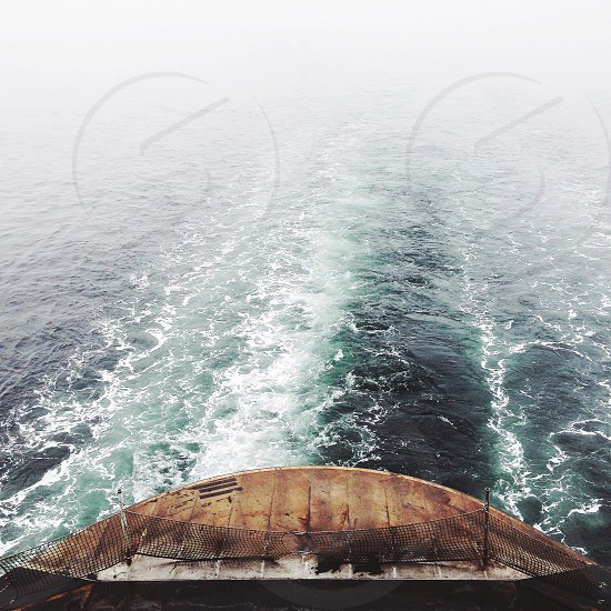 brown canoe on sea photo