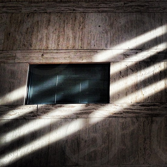 brown wooden wall with black window photo