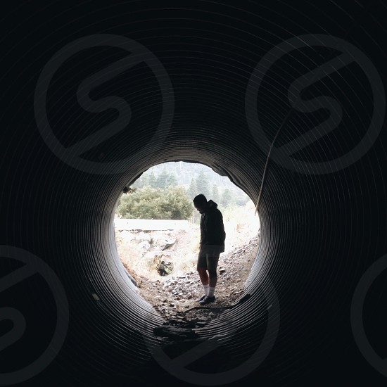 man in silver water drainage photo