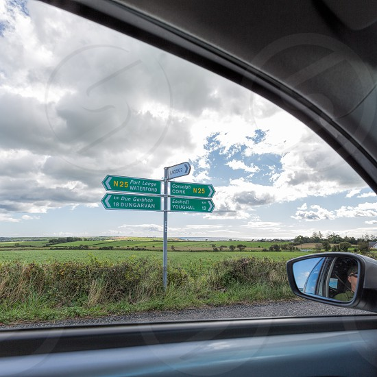 Ireland road sign directions car countryside landscape photo