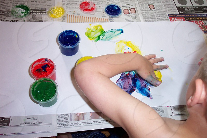 boy finger painting photo