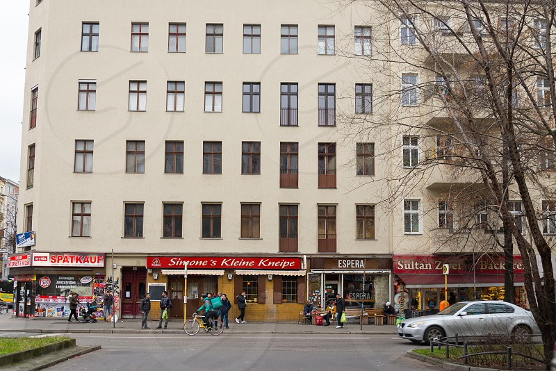 Arab cafe and Spanish cafe are located next each other inside Neukolln Neighborhood in Berlin Germany photo