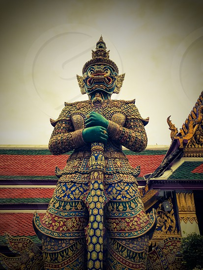 Outdoor day colour vertical portrait Grand Palace Bangkok Thailand Kingdom travel tourism tourist wanderlust gold gold leaf Buddhist Buddhism holy royal regal monarchy temple temples mosaic mirror tile tiles ornate shrine royal regal royalty attraction guard imperial elaborate decorative decoration photo